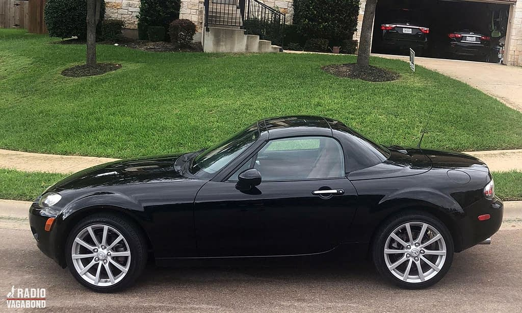 My car is a little black two-seater convertible sports car